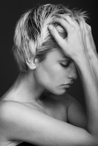 Depression. young attractive woman with an awful migraine